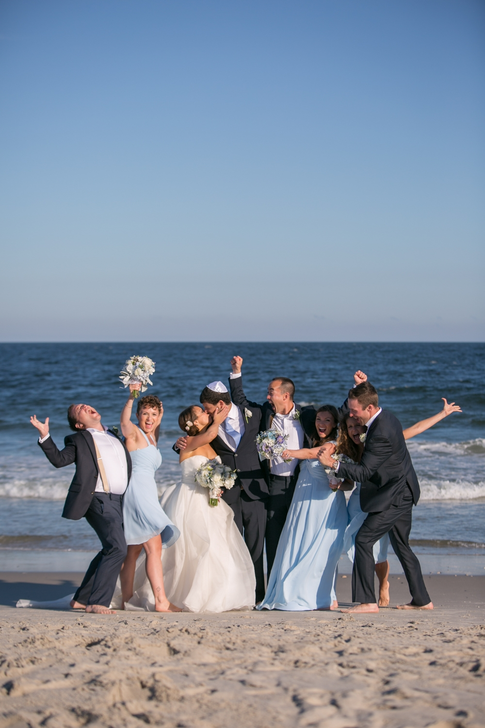 Molly and Jon married on the beach in LBI under a simple chuppah with 200 of their close family, friends. and fun loving bridal party!