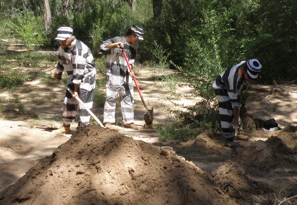 Digging with inmate clothing.  Nora (Left), Eliza (Center) and Alexis (Right) in Espanola, New Mexico.