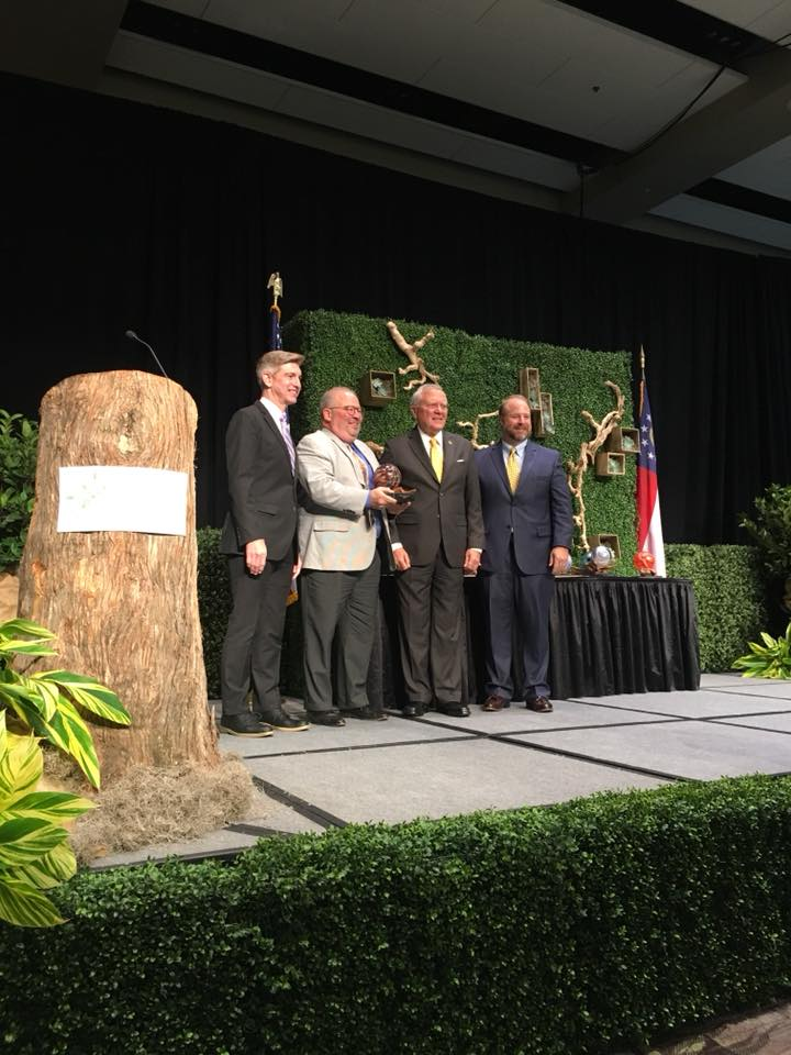 From left to right: Kevin Langston (Deputy Commissioner of Tourism, GDECD), Craig Miller, Governor Nathan Deal and Jay Markwalter (President, GACVB)