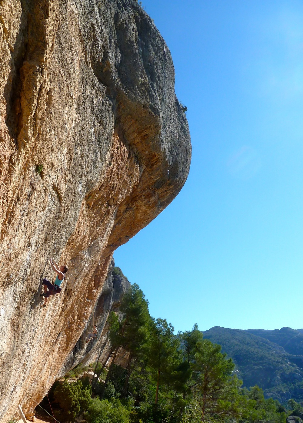 Heather on one of the first classic 7a+'s of Sector Espadelles in Margalef. High on the hill, lots of sun and on this route, lots of thin pockets. Tough for the grade! Camera: iPhone 4S