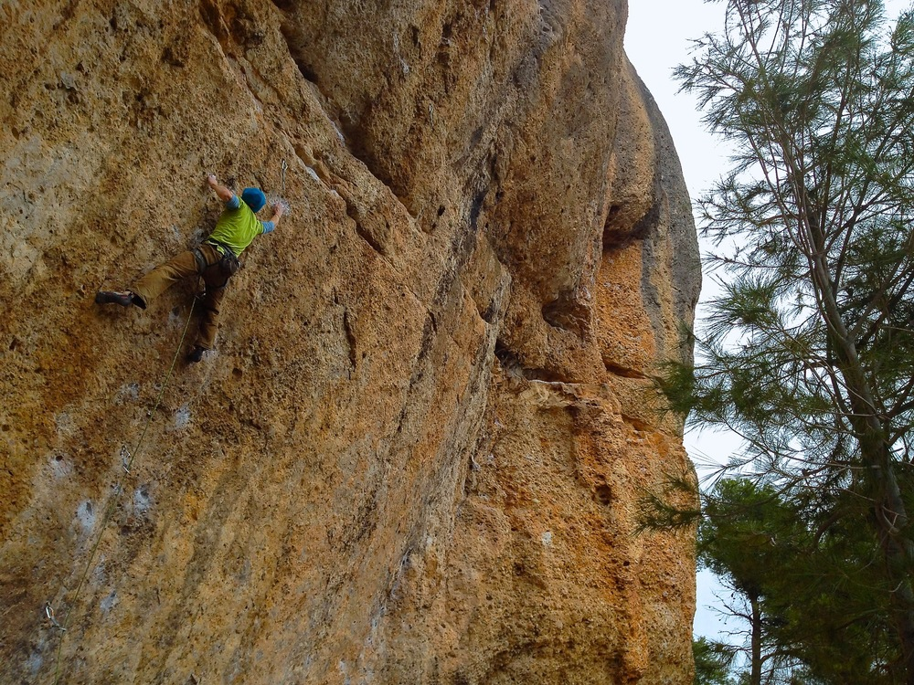 Jonny B pulling down on the early 8a+ moves