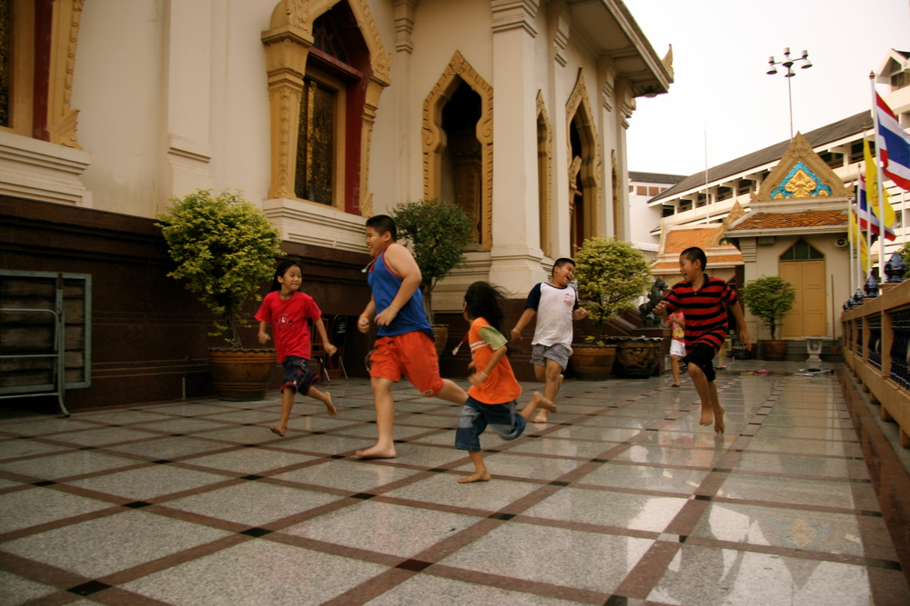 The primary focus of all kids sport - having fun. Unknown temple in Bankgok, Thailand. I got to watch these kids run non-stop for hours on end - non-stop smiles :)