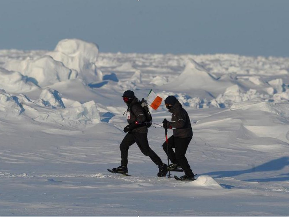 A photo paints a thousand words - it's not hard to understand the mentality needed to run a marathon at the North Pole.