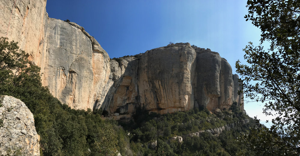 The amphitheater of Raco de Mesa at Monstant. Cliffs of 50+ metres in height, it's hard to appreciate the scale. For those climbing at the level, the route 'Hydrophobia' (8a) comes out along the left hand edge of the shadow in the photo. Can't recommend it enough for pure fun.