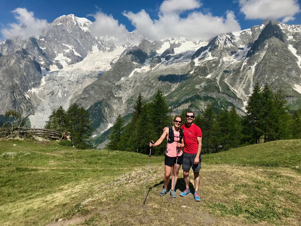 That happy and blissfully ignorant look that we still had another 90km to go! Mont Blanc peaking out of the clouds in the top left.