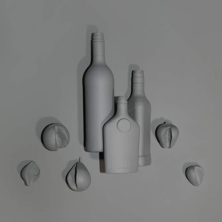 Bottles and Split Fruit
