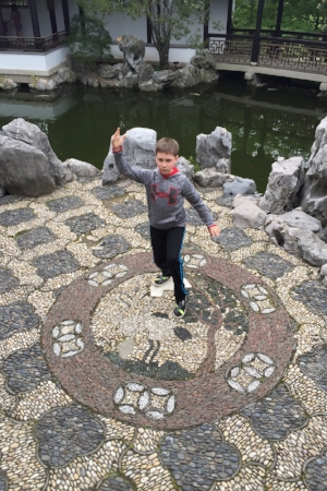 """White Crane Spreads its Wings"" posture demonstrated by Dr. McCann's son Henry, an avid Wushu (Kung Fu) practitioner."