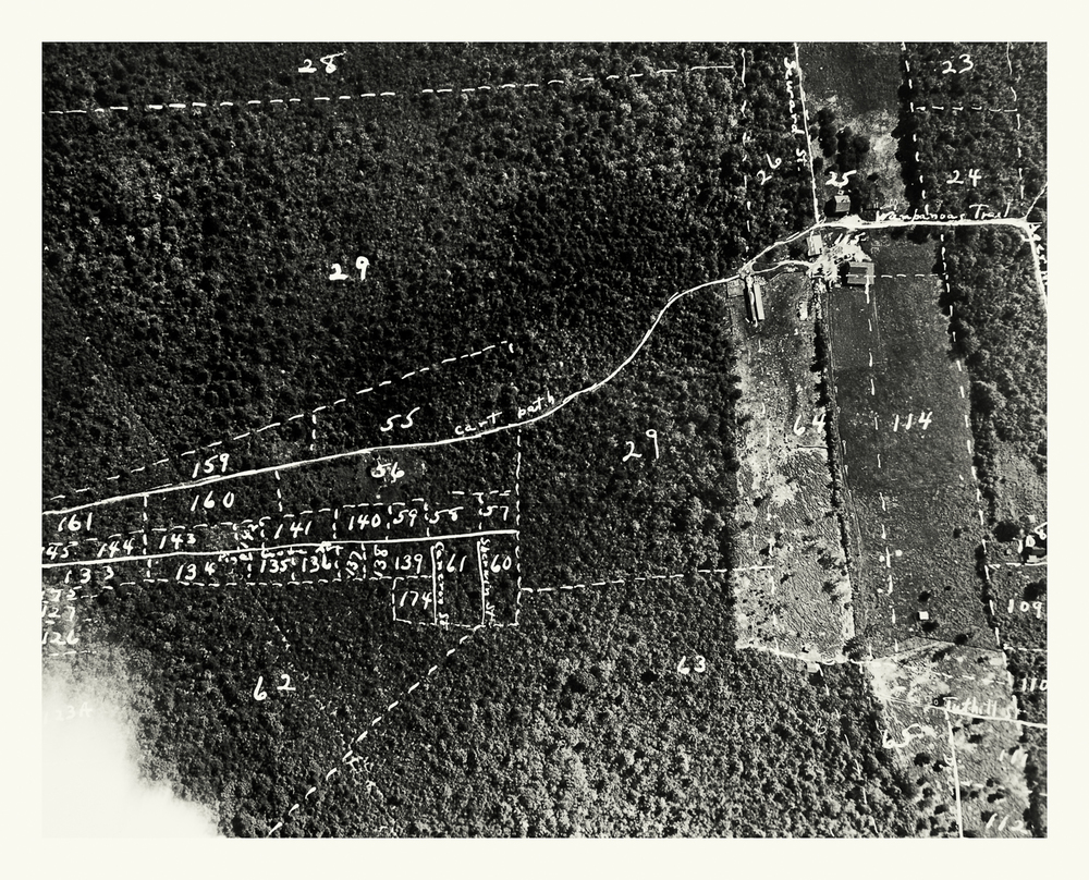 "Photograph No. PC 433. ""Aerial photograph depicting the construction progress on East Group 20 Hi-X Magazines, with Beechwood in the distance. Bunkers located at the Naval Ammunition Depot at Hingham, MA.' March 8, 1942; Records of Naval Districts and Shore Establishments, RG 181, NARA Boston."