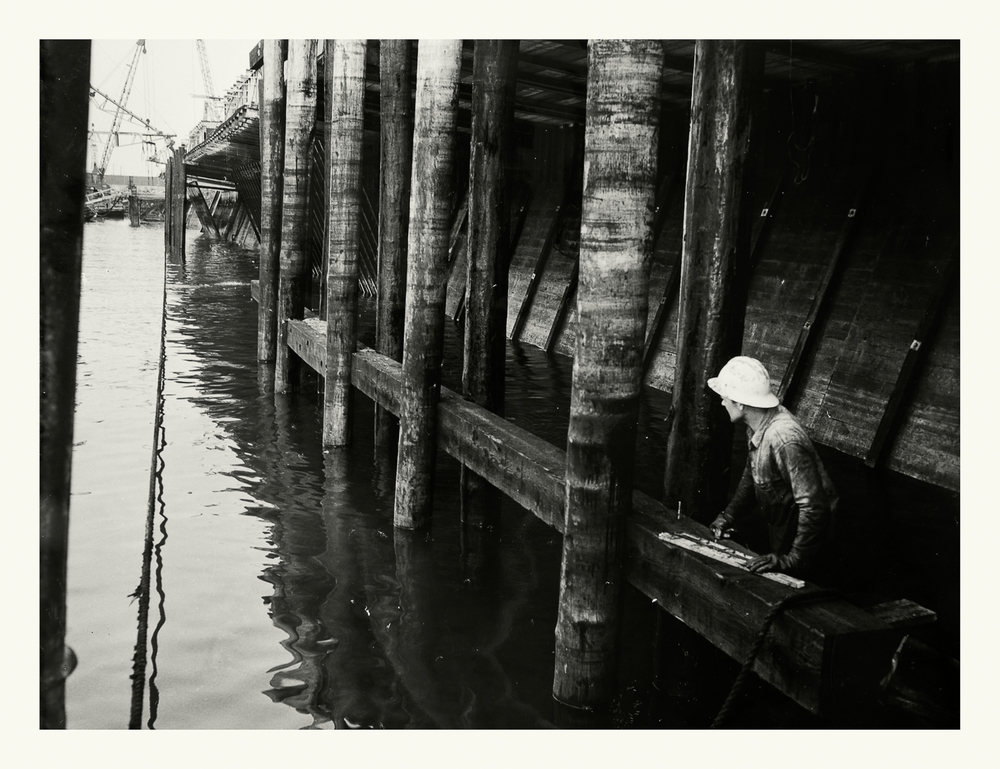 "Photograph No.188. ""Photograph of construction worker under the Boston Army Base Docks."" N.D.; US Army Corps of Engineers. Records of the Office of the Chief of Engineers, 1789-1999, RG 77; NARA Boston."