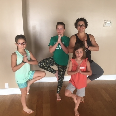 Emily here with her 3 daughters Alex, Riley and Ainsley. They have all been attending the Kid Yoga classes this summer while she goes to the Adult Slow Flow and Yoga/Pilates Fusion classes.