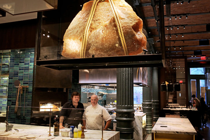The salt shard with chefs Erik Anderson and Linton Hopkins underneath.  Image from the New York Times, click through to see the article.