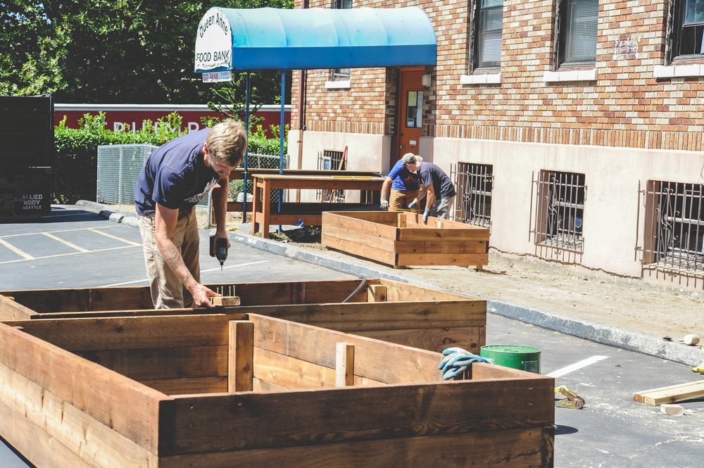 Seattle Urban Farm Co. (SUFCo) Installation Crew building the cedar raised beds