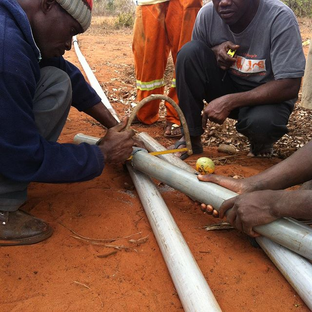 CCO staff repairing broken water wells thanks to your partnership! #waterwellrepair #hacksaw #mozambique