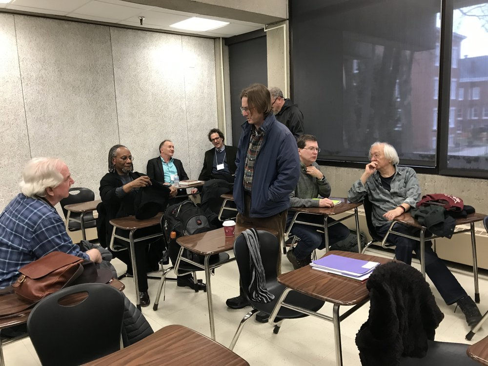 From left: unknown poet, Nathaniel Mackey, Alan Golding, Peter O'Leary, Joshua Hoeynck, Ken Taylor, Joseph Donahue, John Yau