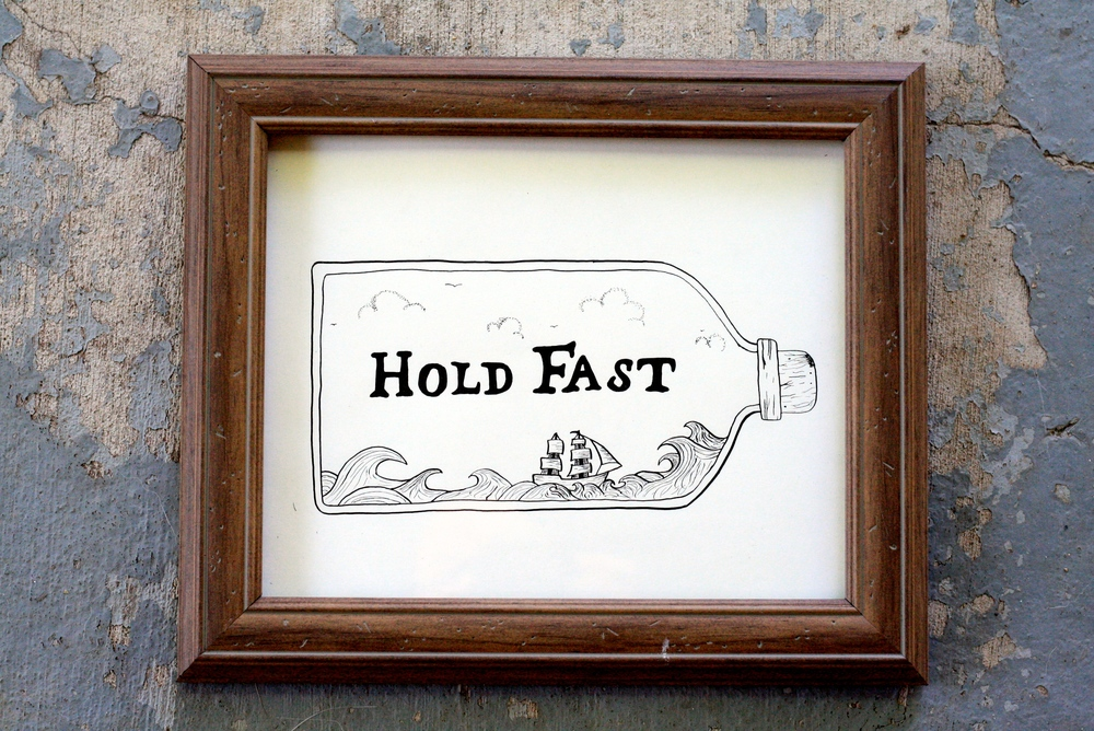 "This beauty  is one that I had done before and re-created a bit. I think ships are freaking awesome, so I try and include them whenever I can. I love the old sailor quotes, like ""Hold Fast,"" as well and wanted to include that. I really enjoy the nature of this one as a bit of rough waves are contained within the corked bottle."
