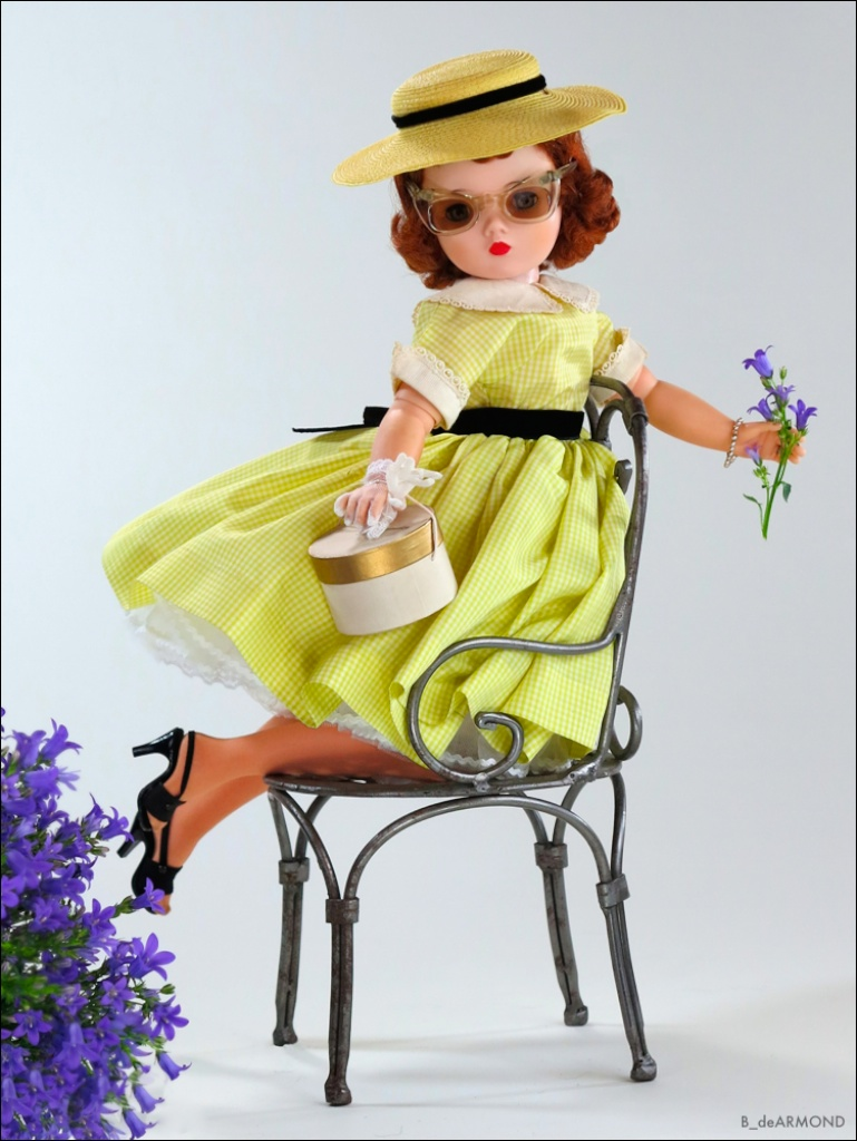 Sitting (variation) is Cissy 1955 very rare boxed yellow checked street dress with matching hat