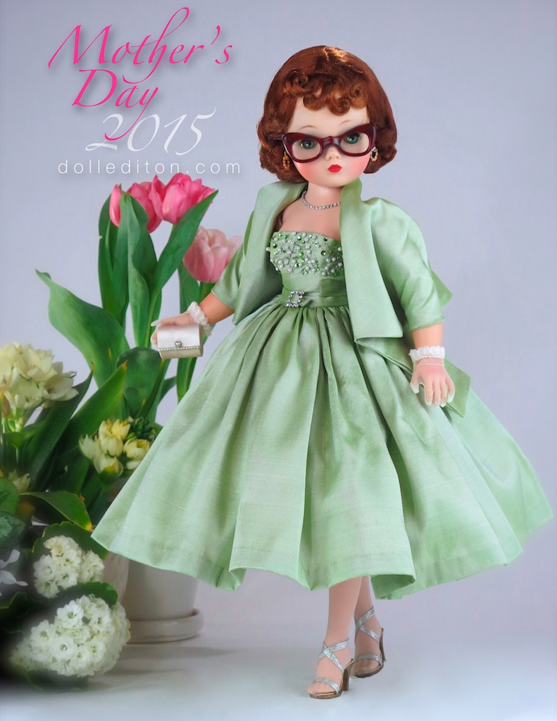 "The gown for my ""Mom Doll"" was created by one of the ladies of my former UFDC Doll Club in Las Vegas. The color was based on Dad's memory. I added flowers to the photo this time around to celebrate Mom's love of gardening."
