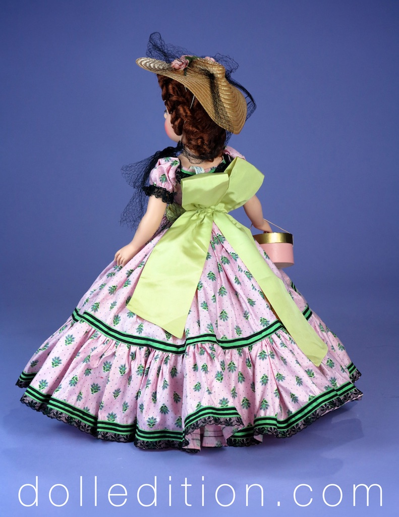 "The dolls of the  Glamor Girls  series are 18"" tall. The dolls are also walking dolls. This was a very important new feature at the time. The large straw hat is trimmed with roses and black millenary veiling."