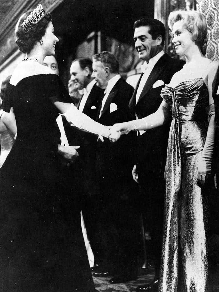 In this October 29, 1956 photo, Queen Elizabeth II meets Marilyn Monroe for the first time. Both 30, the two most famous women in the world have their paths cross at this moment.