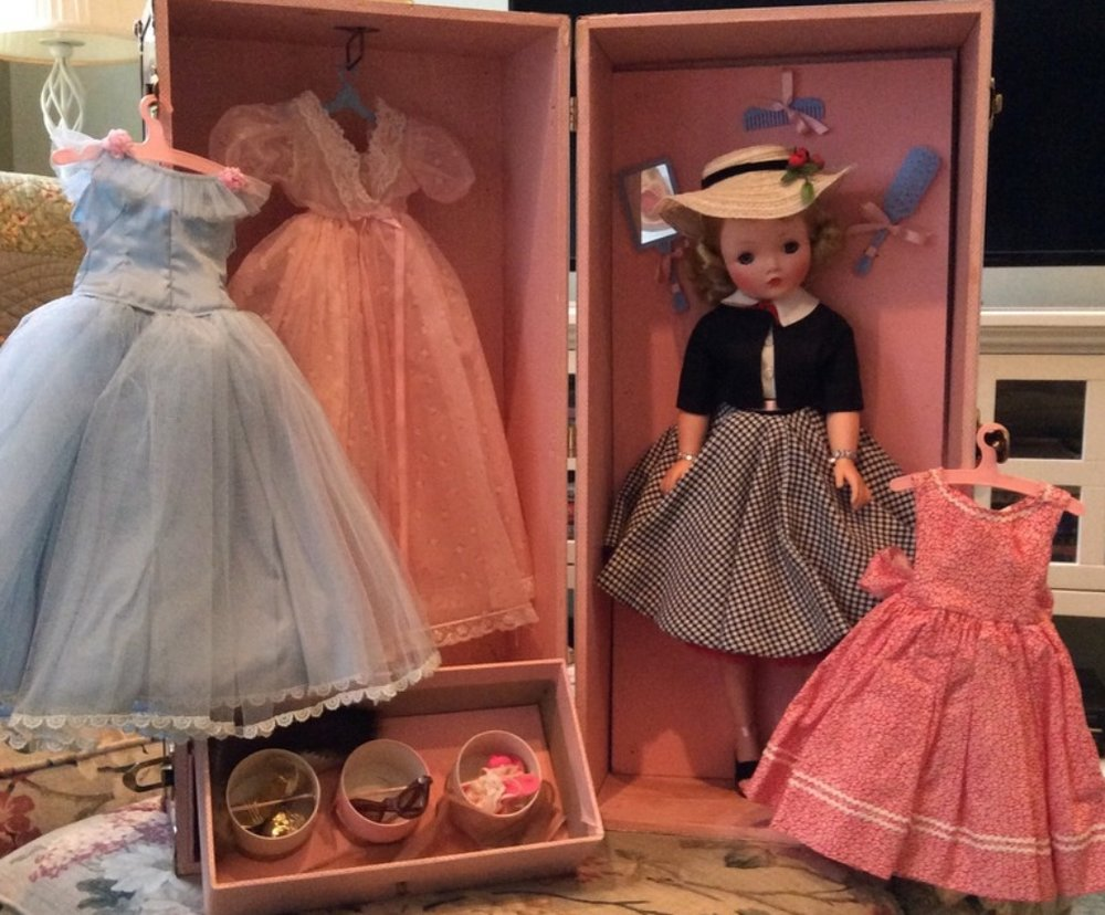 This is one of the actual trunk sets sold by  FAO Schwarz . Filled with clothes and accessories for Cissy, they would fill out the wardrobe with a gown and sundress made by the store.