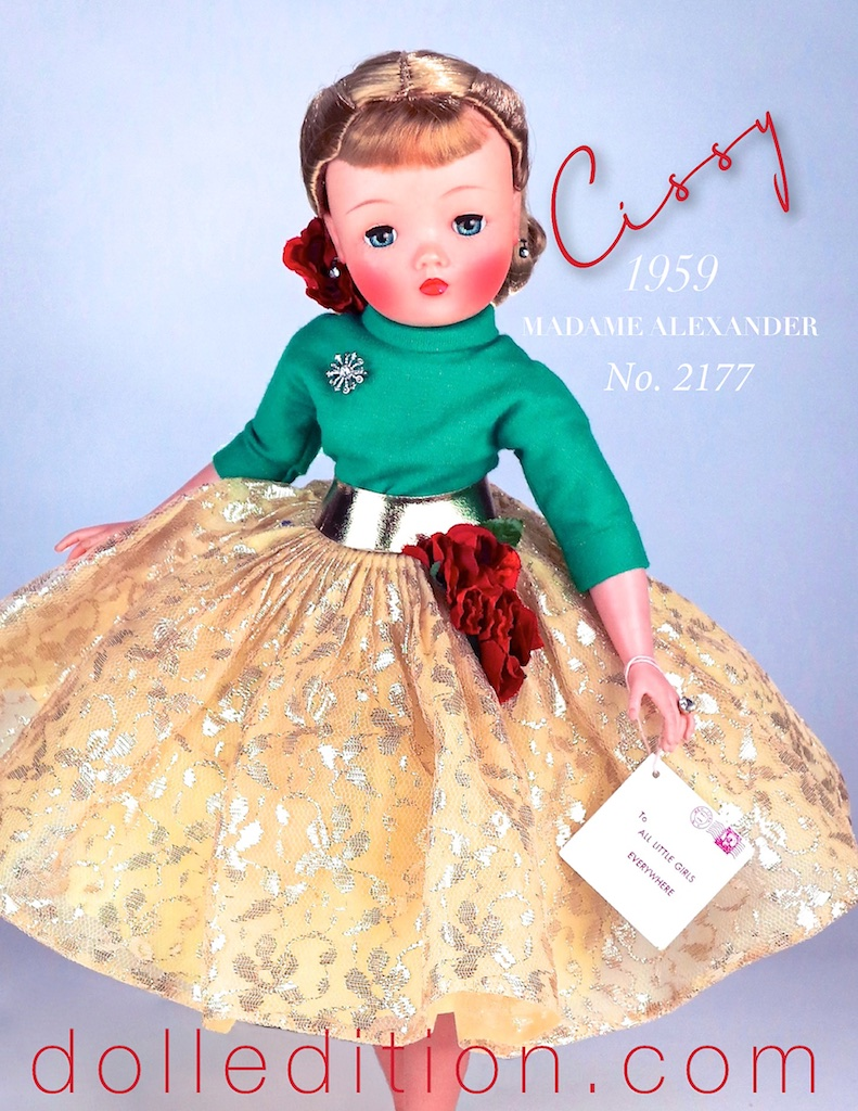 1959 Cissy in a gold skirt and garland of flowers with matching flowers in her hair. She wears a green wool jersey blouse accented with a rhinestone brooch. There is also a variation in a blue wool jersey blouse.