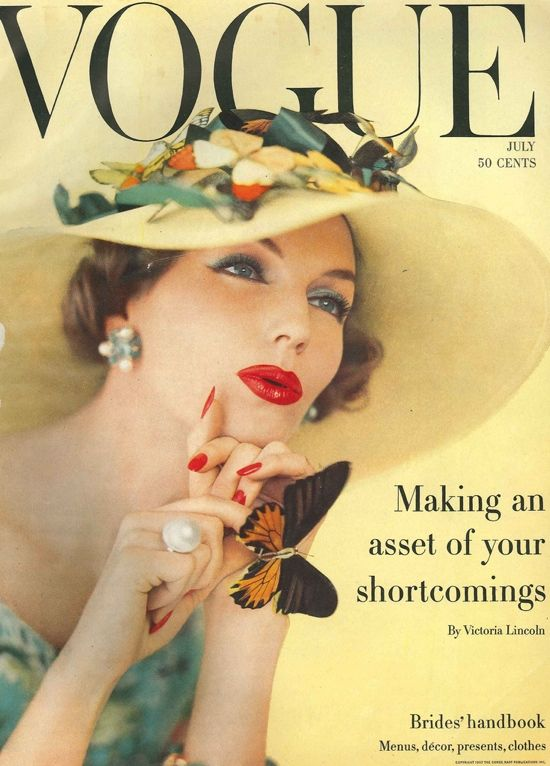 In this Vogue cover, the picture hat is trimmed with butterflies, flowers and leaves.