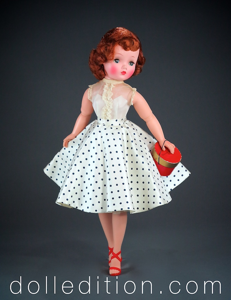 Cissy wears her No. 22-54 circle skirt with navy polka dots with a sleeveless organdy blouse with lace detail .