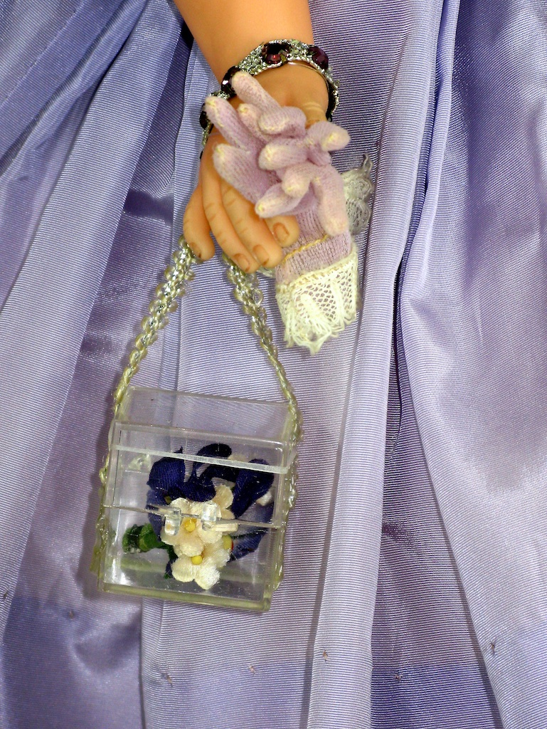 Cissy's lucite purse with floral accents matching her dress and millinary.