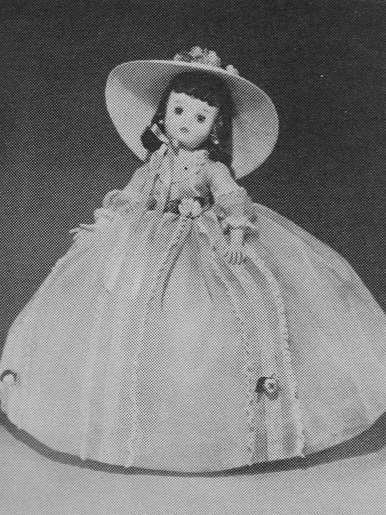 "The 1963 Alexander Doll Company catalog shows their Elise Scarlett with the more familiar Elise mold. The black hair used on this doll is an interesting detail not often seen with the Alexander dolls. Elise has also grown by an inch this year. She now described as an 18"" doll - up from the previous  two years as a 17"" doll. From 1957-1960 Elise is listed as a 16-1/2"" doll."