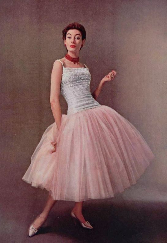 A strong mid-century reference to ballet in this dropped waist, ballerina length interpretation of a tulle tutu.
