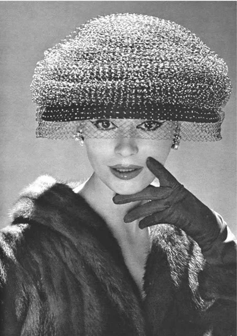 The very popular mushroom style hat of the 1950s — sometimes this style hat was made in matching fabric of the dress.