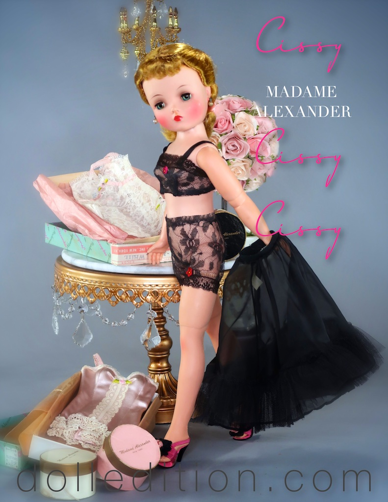 """Cissy"" is reviewing some of her many lingerie options provided by  Madame Alexander  while wearing a black lace lingerie set and black organdy and tulle slip."
