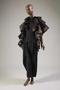 - Issey Miyake, ensemble with synthetic metallic ruffled cape, 1982, Japan, gift of Jun Kanai.