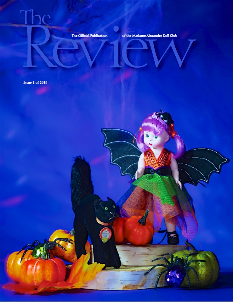 """THE REVIEW, Issue 1, 2019 - the cover featuring the 2018 Fall Friendship doll """"Bootifully Batty."""""""