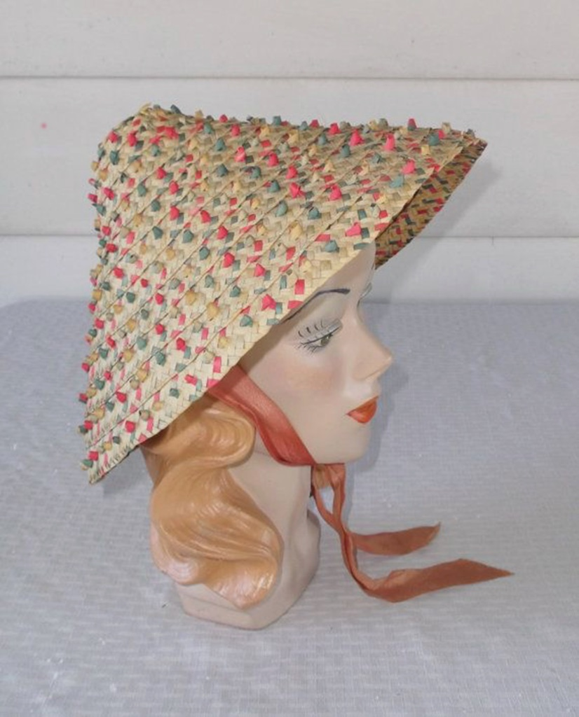 In straw in various weaves and fantasy applications, the pagoda style hat design was a natural favorite for casual or summer 1950s fashion.