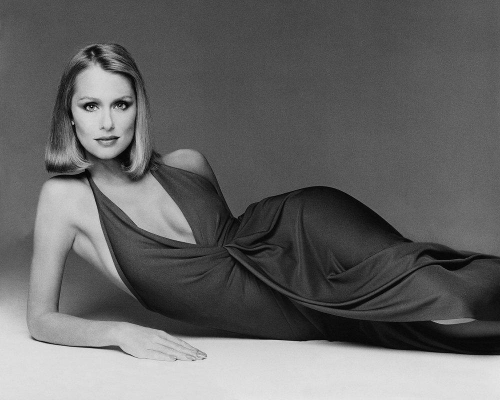 Lauren Hutton in Halston's silk-jersey sarong-wrapped halter dress. Photographed by Francesco Scavullo,Vogue, September 1975