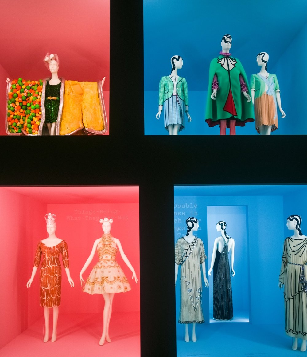 """Clockwise from top left: Jeremy Scott's """"TV Dinner"""" ensemble for Moschino; two Thom Browne dresses flank a green and red ensemble by Alessandro Michele for Gucci; Mr. Michele's dress for Gucci, right, with two of Karl Lagerfeld's early 1980s dresses for Chloé; and a late 1990s Christian Lacroix dress with Mr. Scott's latex prosciutto-looking dress from 2011.CreditDolly Faibyshev for The New York Times"""