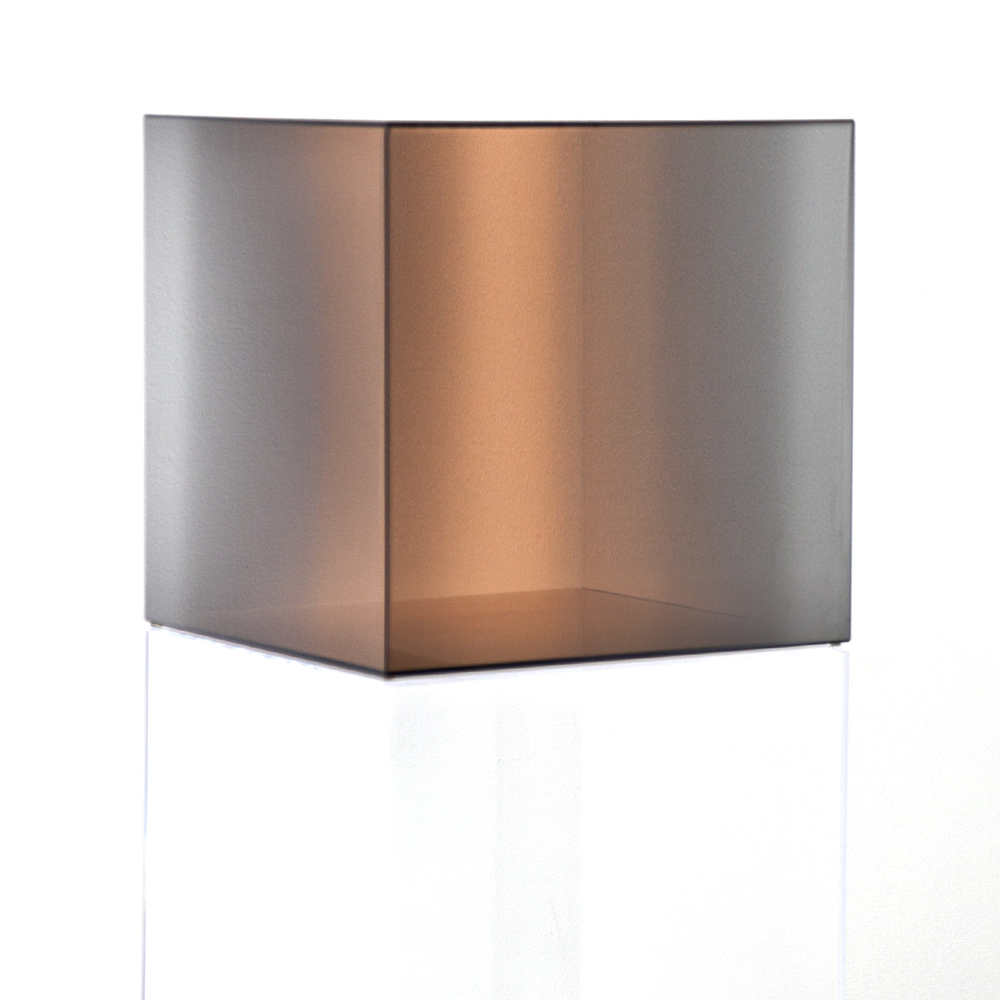 """Larry Bell, """"Cube #31 (Amber),"""" 2006, colored glass coated in Inconel, 20 x 20 x 20 inches"""