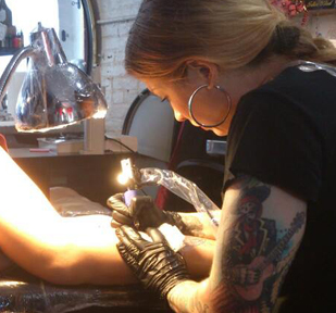 Tattooing at 1228 Tattoo in Williamsburg, summer 2013.