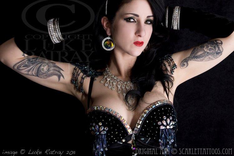 Inner bicep tattoos on Nikki Le Villain, burlesque performer.