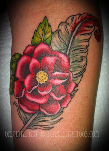 Rose and feather tattoo