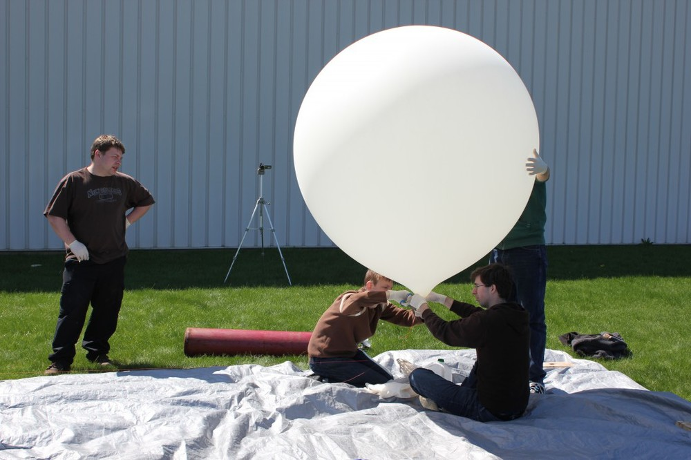 Filling up the balloon.