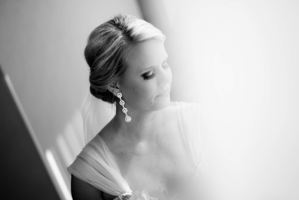 portrait of louisiana bride looking out the window with eyes closed