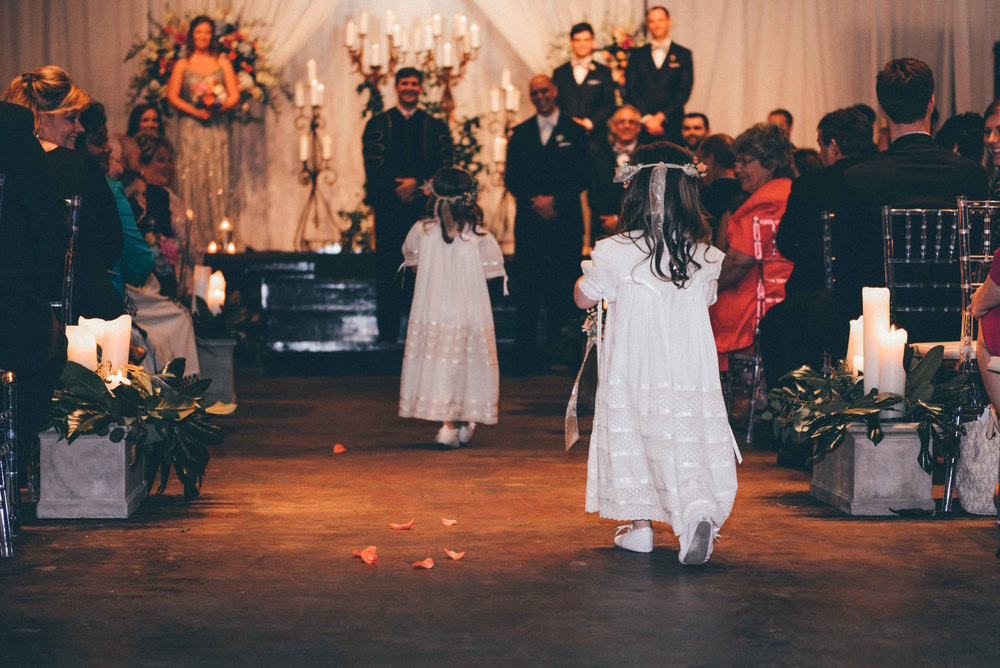 flower girls walking down aisle at louisiana wedding