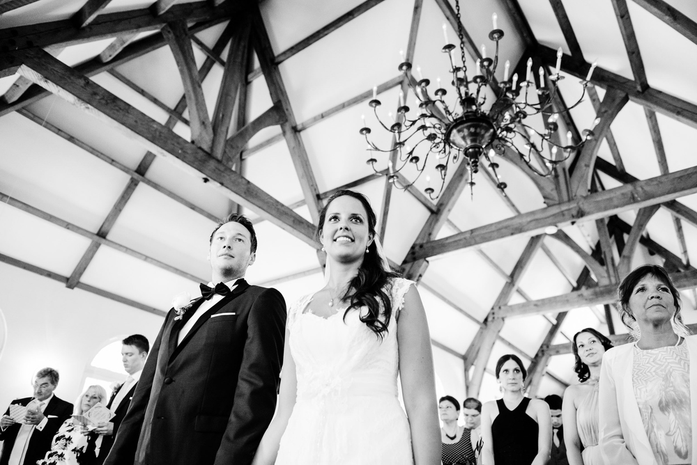 bride and groom during ceremony with ceiling in view