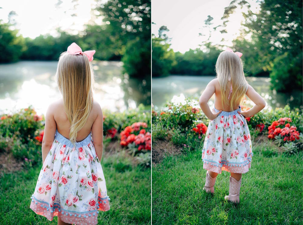 southern blonde girl in flowery dress by lake