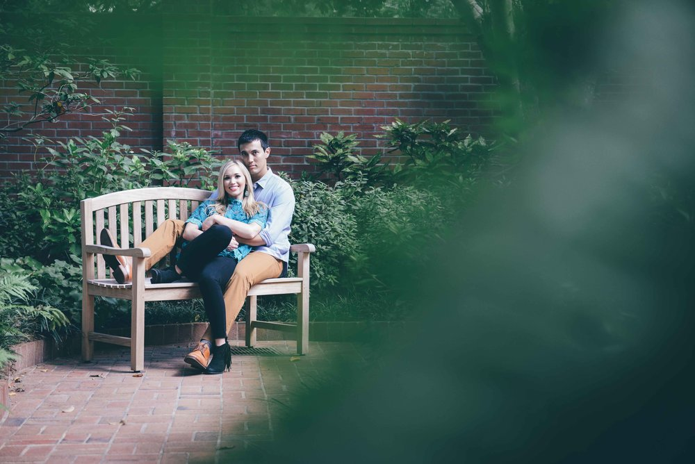 guy and girl sitting on wooden bench