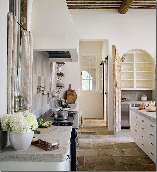 Breadboards with their cuts and scrapes exposed add authenticity to a kitchen and give it a sense of history, an instant backstory that hints at all the delicious things previously cooked. Interior Design by Annelle Primos. Photo by Chipper Hatter via here.