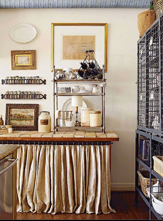 Kitchen of Donna Temple Brown. Love those iron spice racks! Photo via here.