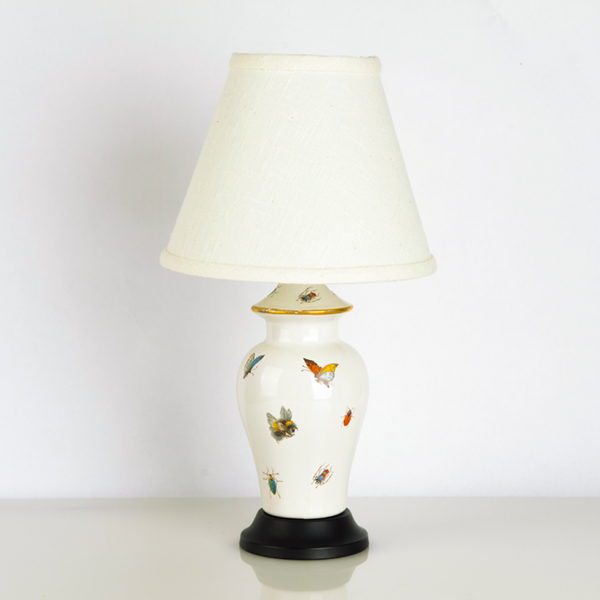 Petite antique French Limoges porcelain lamp with hand-painted insects and butterflies. More information    here   .